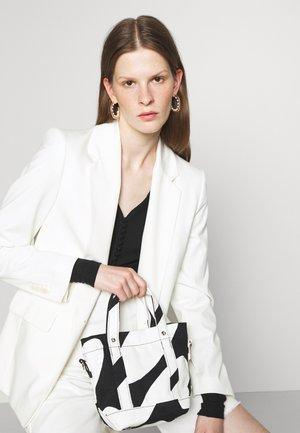 PIKKU PERUSKASSI LINSSI BAG - Handbag - black/white