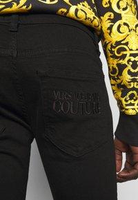 Versace Jeans Couture - AMETIST  - Slim fit jeans - black - 4