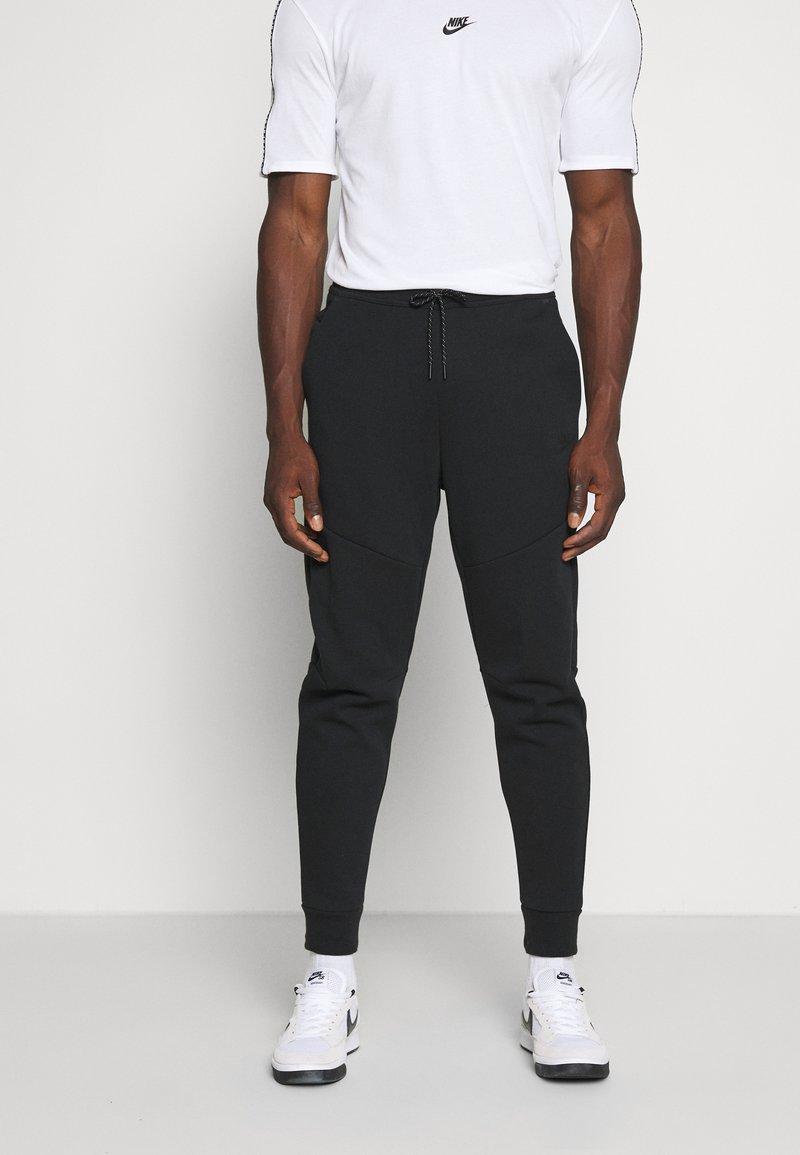 Nike Sportswear - M NSW TCH FLC JGGR - Tracksuit bottoms - black