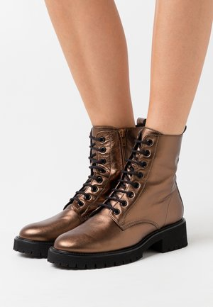Lace-up ankle boots - metallic nut