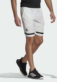 adidas Performance - Sports shorts - white/black - 2