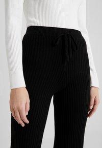 pure cashmere - LONG PANTS - Trousers - black - 4