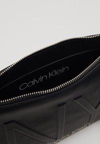 Calvin Klein - SHAPED CROSSBODY - Across body bag - black - 4