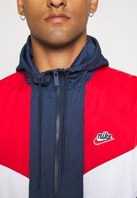 Nike Sportswear - Windbreaker - midnight navy/university red/white - 5