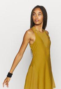 Nike Performance - MARIA DRESS - Sports dress - ochre/black - 3