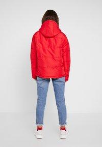 Ellesse - PEJO - Lehká bunda - red - 2