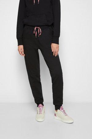 SWEATPANTS - Teplákové kalhoty - black