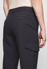 Holzweiler - HAROLD TROUSERS - Cargo trousers - blueberry - 6