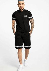 Emporio Armani - Shorts - black - 1