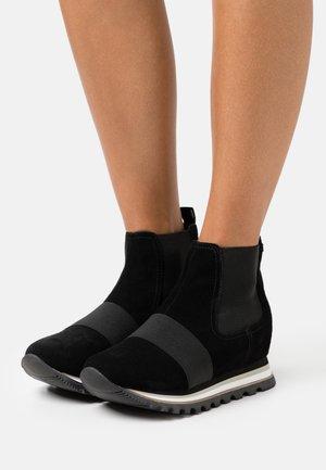 MAARDU - Platform ankle boots - black
