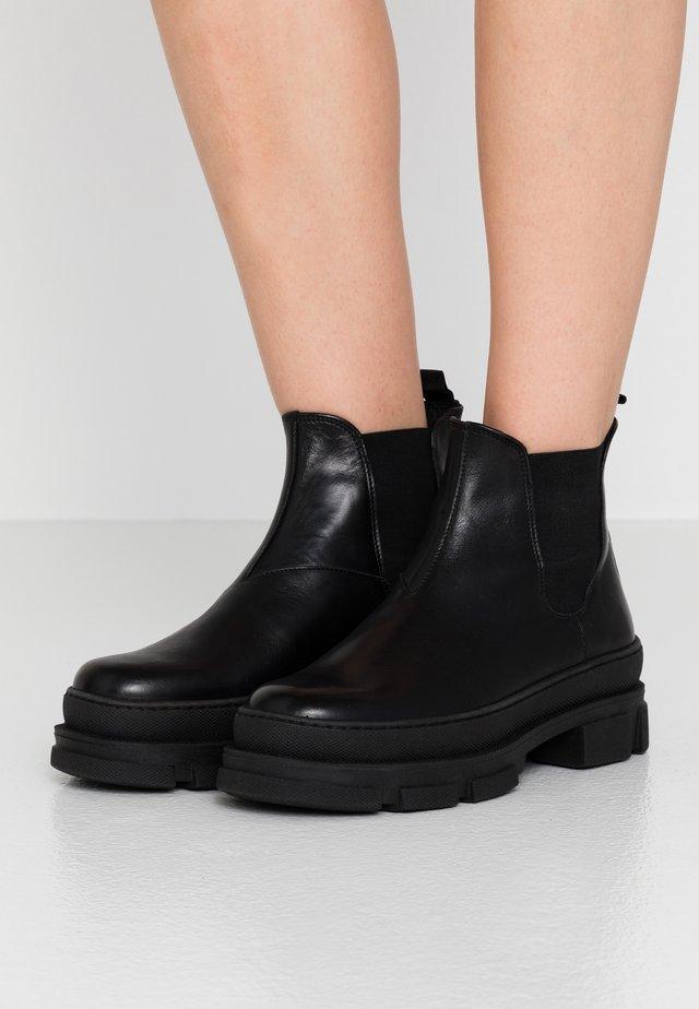 IREAN CHELSEA - Platform ankle boots - black