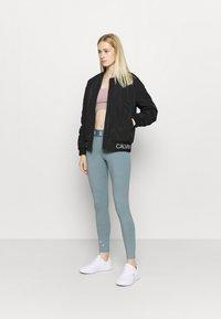 Calvin Klein Performance - PADDED JACKET - Training jacket - black - 1