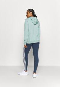 adidas Performance - veste en sweat zippée - haze green/white - 2