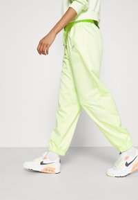 Nike Sportswear - Tracksuit bottoms - lime ice/white - 4