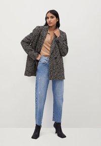 Mango - FOXI - Short coat - schwarz - 1