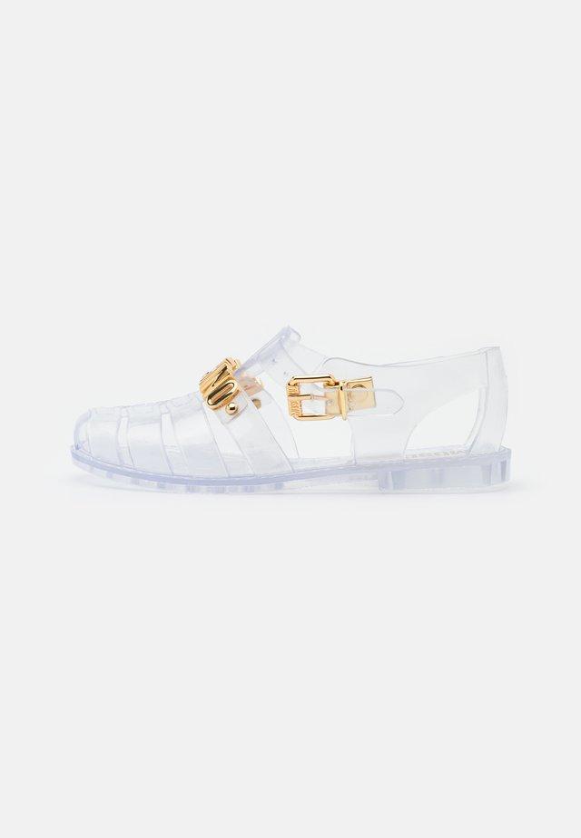 Sandaalit nilkkaremmillä - trasparente