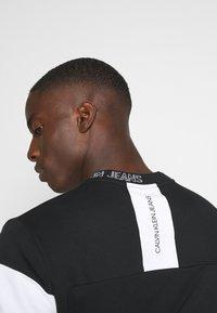 Calvin Klein Jeans - Bluza - black - 3