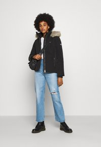 Tommy Jeans - TECHNICAL - Down jacket - black - 1