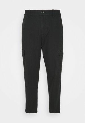 CARPENTER PANT - Cargo trousers - black