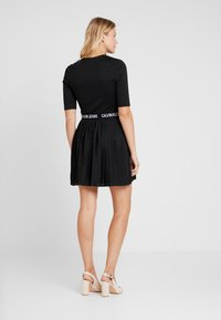 Calvin Klein Jeans - PLEATED DRESS - Jerseyklänning - black - 2