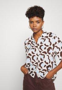 Monki - BITTY BLOUSE - Button-down blouse - offwhite/light blue - 5
