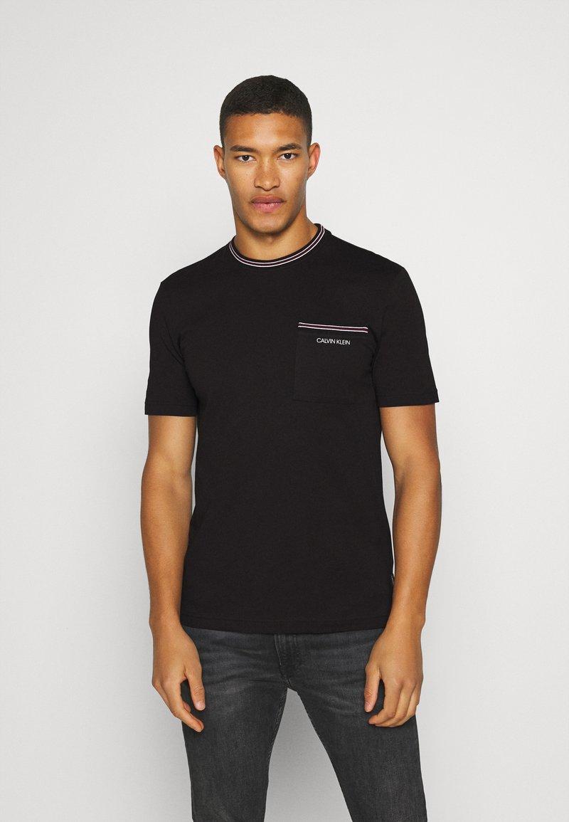 Calvin Klein - RINGER POCKET - T-shirt print - black