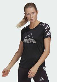 adidas Performance - OWN THE RUN CELEBRATION T-SHIRT - Print T-shirt - black - 0