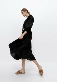 Uterqüe - Korte jurk - black - 1
