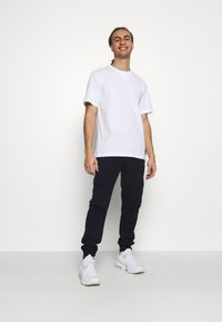 Champion - CUFF PANTS - Tracksuit bottoms - navy - 1
