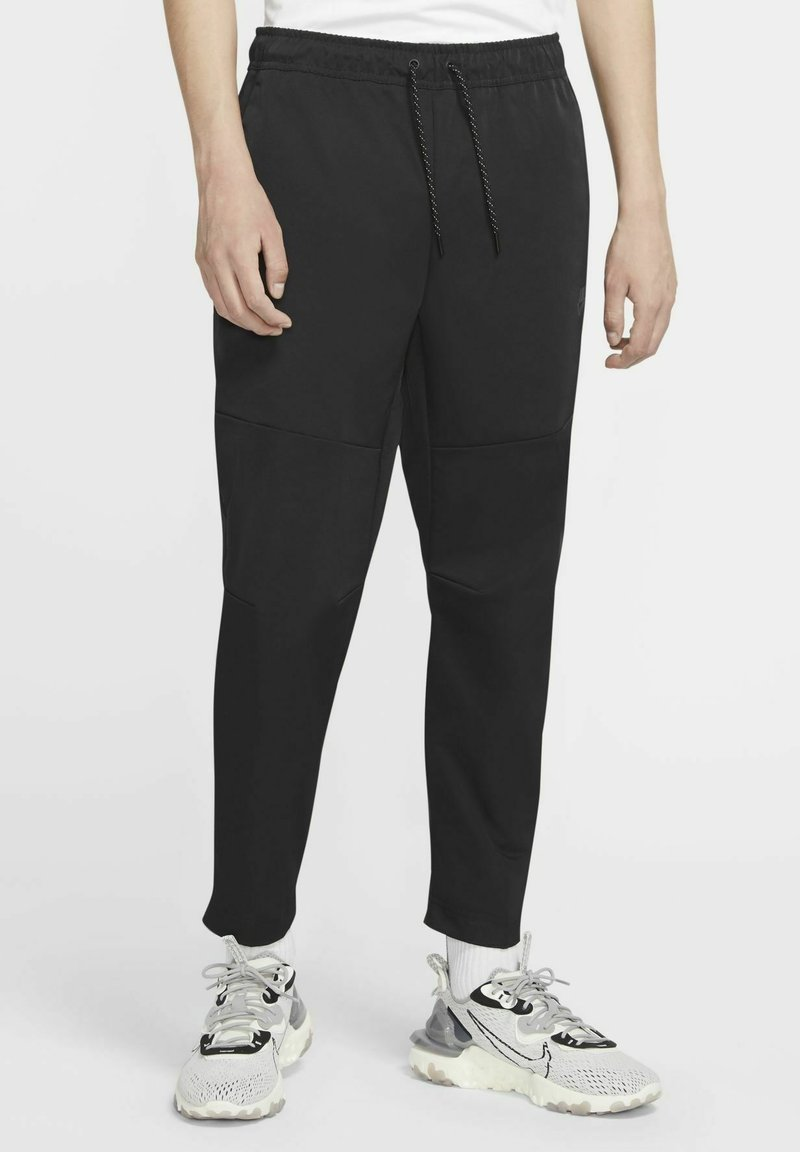 Nike Sportswear - Tracksuit bottoms - black/black