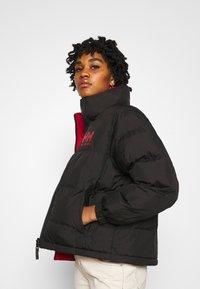 Helly Hansen - W HH  - Winter jacket - black - 4
