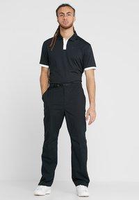 Nike Golf - DRY VAPOR - T-shirt de sport - black/white - 1