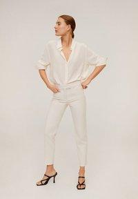 Mango - ALBERTO - Trousers - Cream white - 1