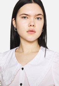 Monki - SANDRA BLOUSE - Button-down blouse - white - 4