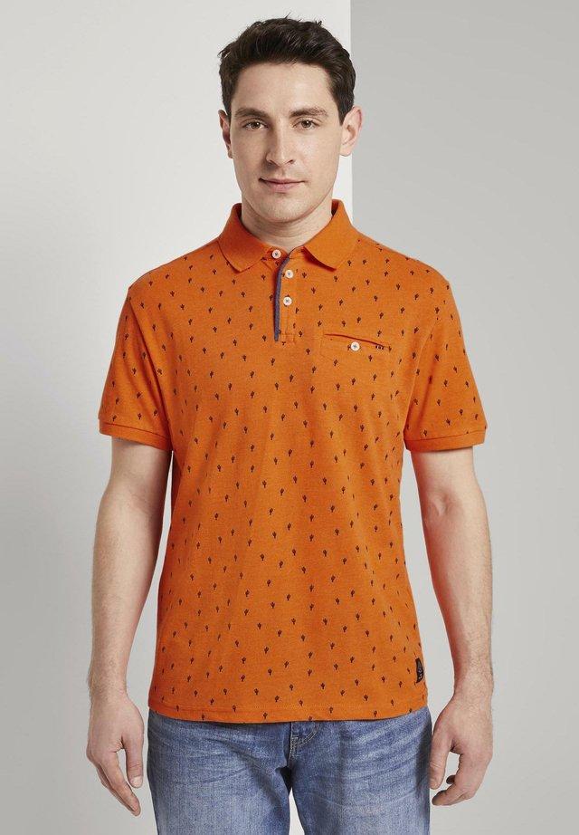Polo - orange blue cactus design