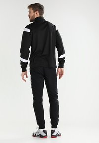 Hummel - AUTHENTIC CHARGE  - Tracksuit bottoms - black - 2