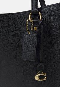 Coach - POLISHED TYLER CARRYALL - Weekend bag - black - 6