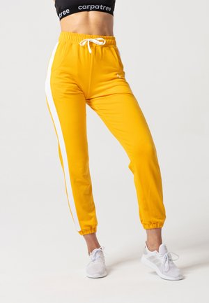 RELAXED SWEATPANTS - Verryttelyhousut - yellow
