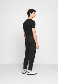 Just Cavalli - PANTALONE - Trousers - black - 2