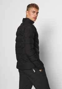 Puma - WARMCELL LIGHTWEIGHT JACKET - Winterjas - black - 2