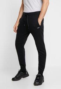 Hollister Co. - CORE  - Teplákové kalhoty - black - 0