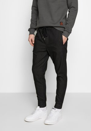 FINN - Trousers - black