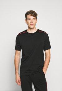 HUGO - DYRTID - T-shirts print - black - 0