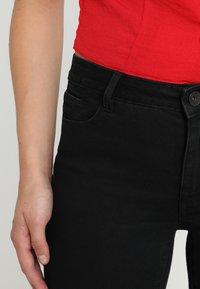 Vero Moda - VMJULIA FLEX IT MR SLIM JEGGING GU1 - Jeans Skinny Fit - black - 5