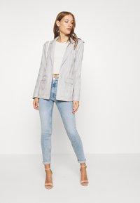 Calvin Klein Jeans - HIGH RISE SKINNY - Jeans Skinny - light blue - 1