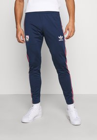 adidas Originals - Tracksuit bottoms - collegiate navy - 0