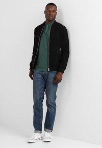 Selected Homme - SLHLUKE SLIM FIT - Polo shirt - trekking green - 1