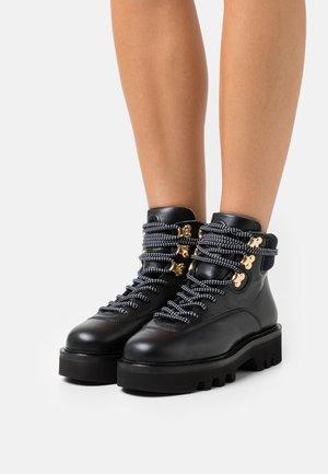 RITA HIKING BOOT  - Platform ankle boots - nero
