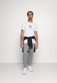 Calvin Klein Performance - Pantalon de survêtement - grey - 1