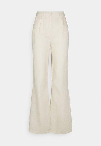 FLARED PANTS - Bukse - light beige